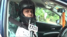 man-spotted-wearing-helmet-in-car