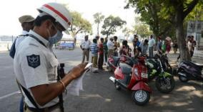 andhra-cops-giving-helmets-documents-instead-of-challans