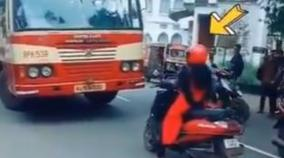 kerala-women-stops-her-scooty-infront-of-a-erring-bus-which-came-along-wrong-lane