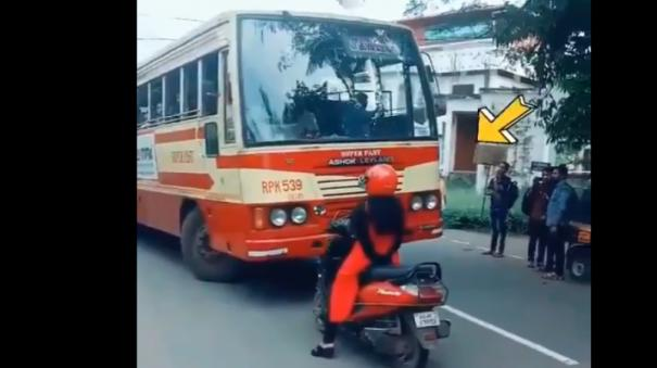 kerala-woman-stops-scooty-in-front-of-bus