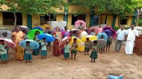 old-student-gifts-school-children-with-umbrellas