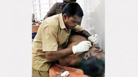 sanitary-worker-treats-injured-in-gov-hospital