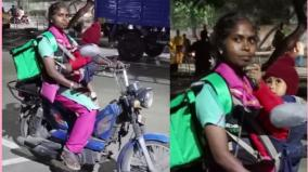 a-woman-who-has-been-feeding-her-uninvolved-baby-on-her-shoulder-for-a-living-has-been-supplying-food-all-day-in-chennai-the-child-is-only-one-year-old