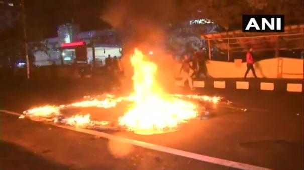 bus-torched-by-protesters-dispur