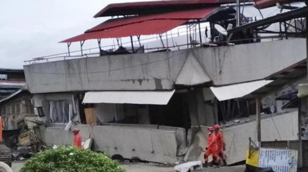 rescuers-search-building-rubble-after-in-philippines-quake
