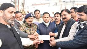 muslims-give-rs-6-lakh-cheque-as-damage-compensation-during-protests-to-up-govt