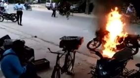 man-sets-motorcycle-on-fire-after-being-challaned-for-riding-without-helmet-arrested