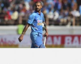 dhawan-hit-on-rib-cage-struggles-against-pat-cummins-bouncers