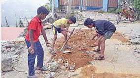 students-repairing-damaged-road-near-kodaikanal