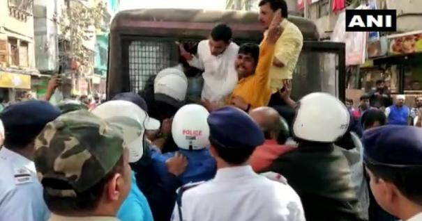 detained-bjp-youth-wing-workers-for-performing-bharat-mata-puja