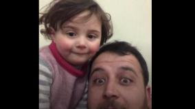 dad-teaches-little-girl-to-laugh-as-bombs-fall-in-syria