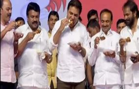 telangana-ministers-eat-chicken-on-public-stage-to-dispel-rumours-about-coronavirus