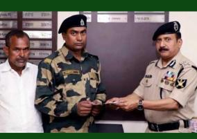 bsf-hands-over-rs-10l-cheque-to-jawan-whose-house-was-burnt-in-delhi-riots