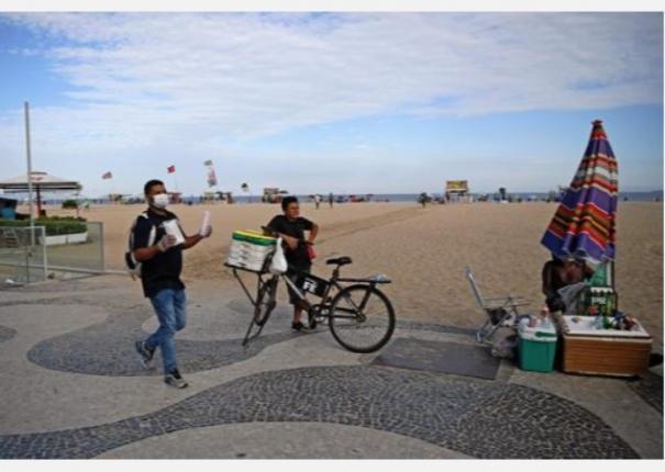 with-megaphones-brazil-orders-rio-beach-goers-home