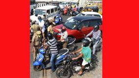 police-collecting-numbers-of-outside-vehicles-action-soon