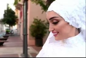 a-bride-in-beirut-poses-for-photographs-moments-before-a-massive
