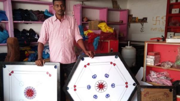 6 பேர் விளையாடும் வகையில் அறுங்கோண கேரம் போர்டு தயாரித்த சிங்கம்புணரி கடை உரிமையாளர்  569225