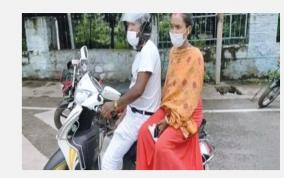 man-takes-pregnant-wife-in-scooter