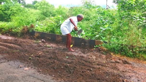 senior-citizen-repairs-road
