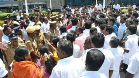 admk-banner-damaged-in-airport-ruckus-by-cadres