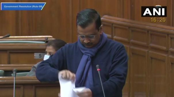 kejriwal-tears-copies-of-centre-s-farm-laws-says-cannot-betray-farmers