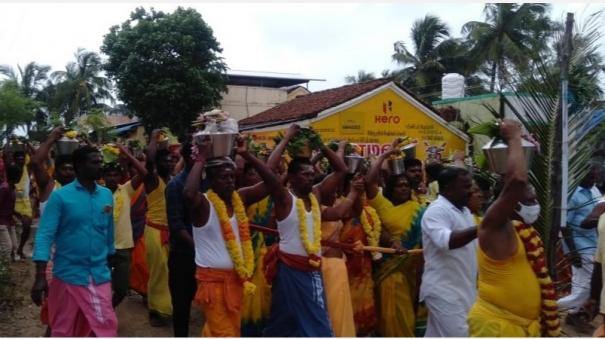 devotees-take-a-jug-of-milk-and-worship-at-the-renukadevi-amman-temple-in-karaikalmedu