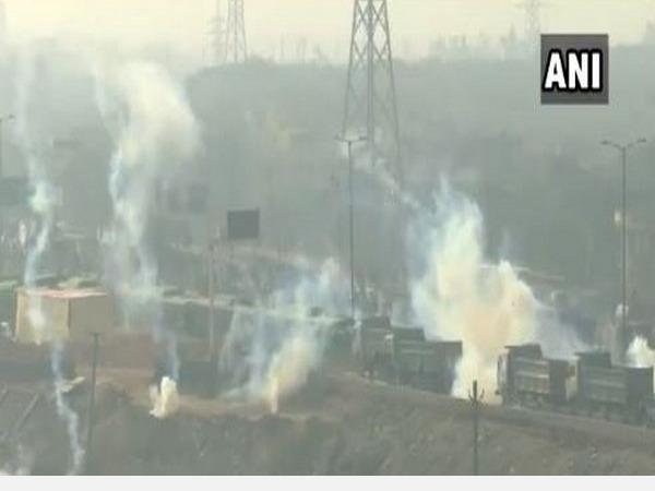tear-gas-shells-fired-at-farmers-trying-to-break-barriers-with-tractors-at-delhi-s-mukarba-chowk