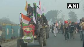 farmers-knock-down-police-barricades-ahead-of-tractor-rally-in-delhi