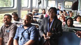 female-ticket-examiner-entertaining-passengers-on-the-nilgiri-mountain-train