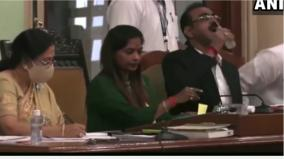 bmc-official-drinks-sanitizer-while-presenting-education-budget