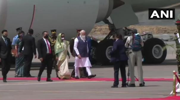 pm-modi-arrives-in-bangladesh-on-his-first-foreign-trip-since-covid-19-outbreak