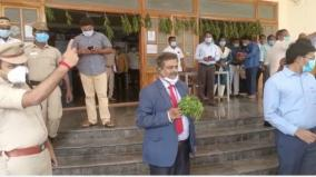 chief-information-commissioner-of-the-state-who-came-to-the-tanjore-collector-s-office-with-a-camomile-in-his-hand
