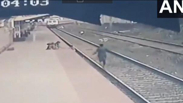 pointsman-saves-child-from-getting-crushed-under-train-in-mumbai