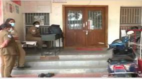 woman-inspector-locked-police-station