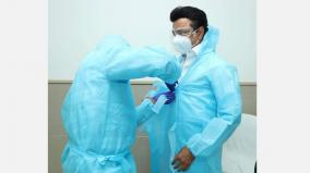 chief-minister-wearing-ppe-uniform-and-inquiring-about-the-health-of-corona-patients