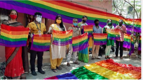 flying-rainbow-flag-in-front-of-front-field-workers