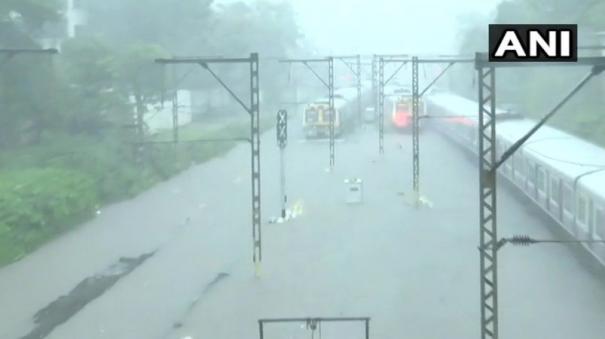 waterlogging-stalls-trains-traffic-as-monsoon-reaches-mumbai