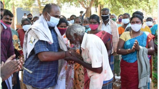 villagers-celebrating-the-birthday-of-a-grama-niladhari-who-served-without-giving-money-flexibility-near-thanjavur