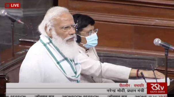pm-modi-as-the-opposition-creates-ruckus-in-rajya-sabha