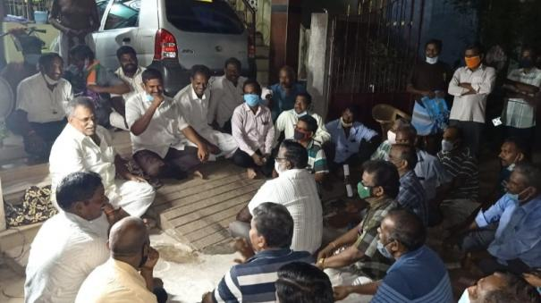 puducherry-law-sitting-on-the-ground-and-listening