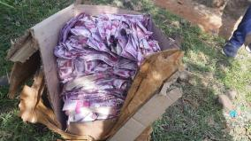excitement-with-toy-banknotes-lying-on-the-side-of-the-railway-track-near-dharmapuri