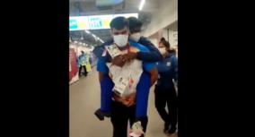 heart-warming-visuals-of-paralympian-sandeep-celebrating-by-carrying-thangavelu