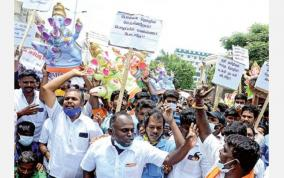 protest-with-ganesh-statue