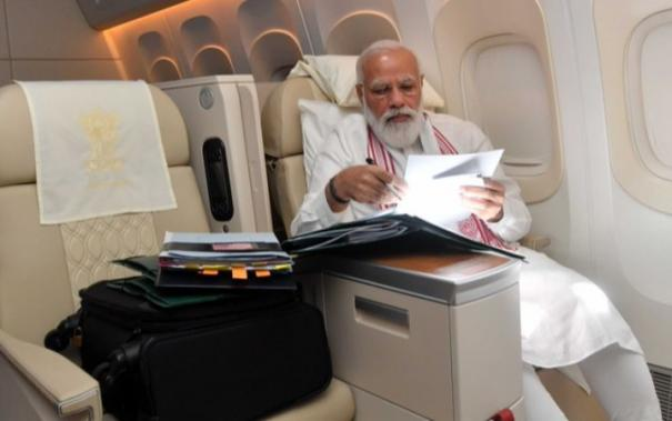 indian-prime-ministers-were-clicked-working-onboard-a-flight