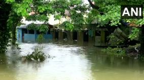 water-from-overflowing-pampa-river-enters-nearby-houses-following-heavy-rainfall-in-the-area-in-pathanamthitta
