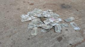 money-thrown-in-the-street-stir-by-bargain-for-panchayat-vice-president